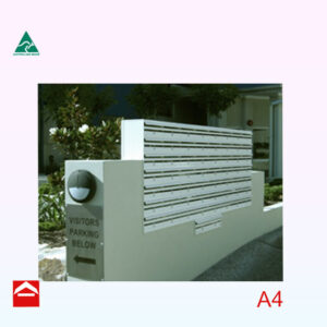 Bank of aluminium A4 letterboxes that are mounted on top of a wall.