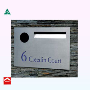 Stainless steel front plate with laser cutting and mail slot and paper holder with rear open aluminium letterbox behind