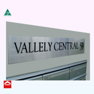 Image of stainless steel with laser cut words Vallely Central 59