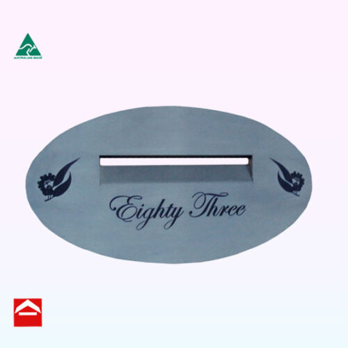 Image of oval shaped stainless steel front plate with mail slot and engraved words and image